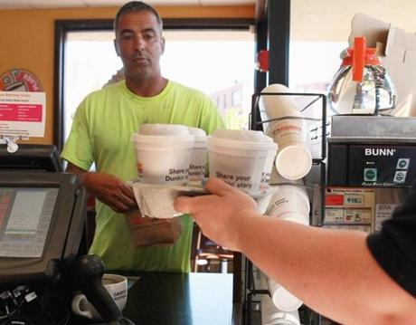 Dunkin' Donuts says it does not yet know how much of a price increase for coffee it will recommend to franchisees.